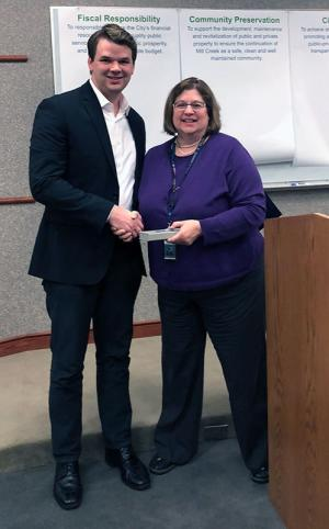Brian Davern receives service recognition plaque from City Manager Rebecca Polizzotto. Photo credit: Joni Kirk.