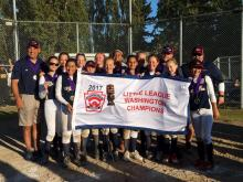 Mill Creek Little League 12s softball team with Washington State Championship banner. Photo courtesy of Mill Creek Little League.