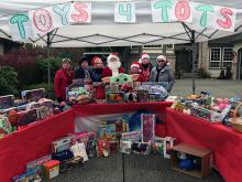 """Nearing the end of what some could arguably call a """"Bah Humbug"""" year, Mill Creek Garden Club delivered Christmas spirit. Wondrously we did have help from the jolly guy in the red suit and a merry band of Masked Elves."""