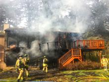 A family of four – two adults and two children – safely escaped a fire that caused heavy damage to their home east of Lynnwood on Monday afternoon, April 9, 2018.