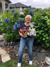 """Mill Creek Garden Club finished a summer bonanza series of raffles with its final winner last week. Thanks to volunteer Donna Werner who generously put together what I call a """"go ahead, make my day"""" raffle basket for our lucky winner, Gail Fraioli."""