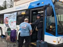 Volunteers stuff a bus with donated items in December 2016. Photo courtesy of Community Transit.