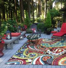 Bright colors and cheerful flowers bring joy to this deck in Fairway. Photo courtesy of Mill Creek Garden Club.