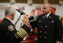 Fire Chief Gary Meek swearing in Battalion Chief Evan Adolf. Photo courtesy of Fire District 7.