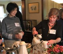 Julie serves tea to new member, Hyun. Photo courtesy of Mill Creek Garden Club.