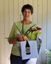 Most Mill Creek Garden Club members would agree, no matter the state of the world, put us in a garden, toss in some wine, chocolate, and a little candlelight, and we will create a haven for the soul.LeAnn Venn was the happy recipient of the lovely basket—it's the luck of the draw!