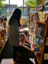 Looking for coloring books at the Mill Creek University Bookstore. Photo credit: Jessica Perez.