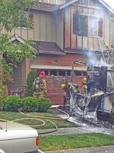 Firefighters were dispatched at 11:27 am on Monday, May 13th, to a report of a vehicle fire that was spreading to the nearby house east of Mill Creek. When crews arrived on scene they found a work truck on fire in the driveway with the fire spreading to the house.