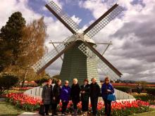 Some of the Garden Club gang at RoozenGaarde's windmill. Photo courtesy of Mill Creek Garden Club.