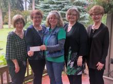 MCGC's check is presented to Zsofia Pasztor of Farmer Frog (3rd from left). Photo courtesy of Mill Creek Garden Club.