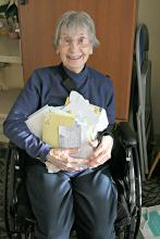 Mill Creek Senior Center volunteer Joan Buxton with 105 get well cards she received after an illness last year. Photo courtesy of Mill Creek Senior Center.