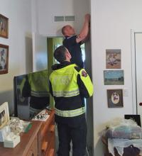Firefighters Matthew Wier and Scott Dorsey from South County Fire install a smoke alarm in a mobile home in Lynnwood. Photo courtesy of South Snohomish County Fire and Rescue.